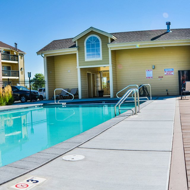 Newport Village - Pool with deck chairs and clubhouse