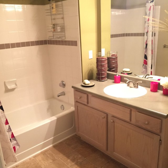 Newport Village - Master bathroom with bath and shower combo