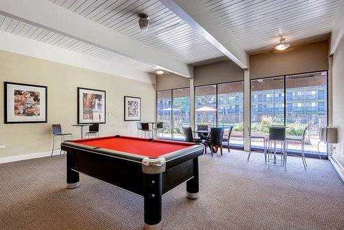 Mosaic Apartments - Clubhouse with Billiards Table and Tables in view.