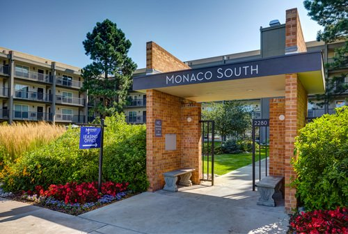 Monaco South - Exterior of Apartments with Pool Area