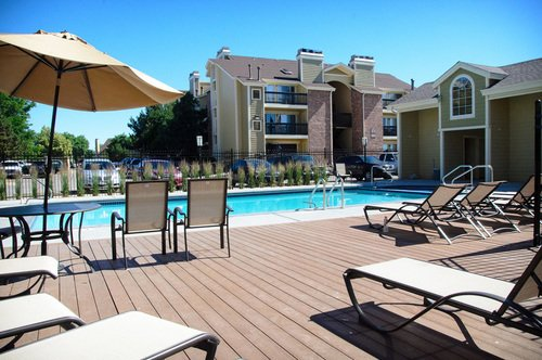 Newport Village - Pool with chairs and umbrella
