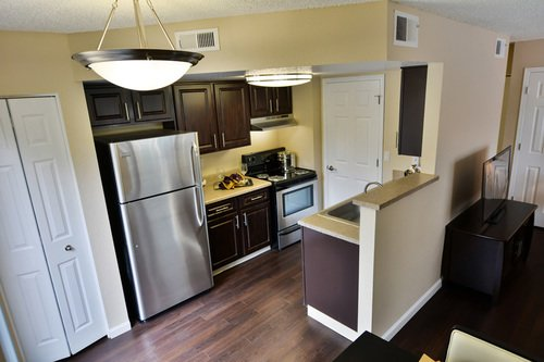 Newport Village - kitchen with dark wood floors